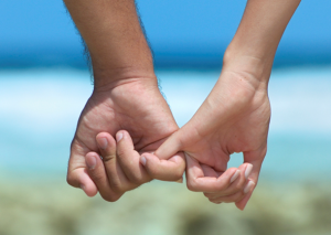 couples-holding-hands-at-beach-300x213